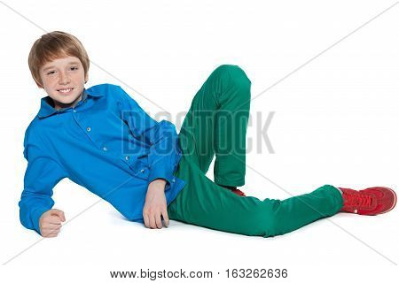 Preteen Boy Is Lying On The White Background