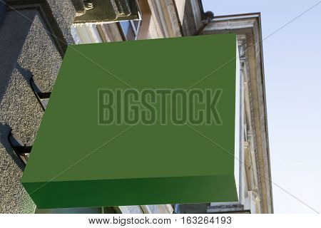 Greenery mock up. Square shape signboard on wall. Low angle view.