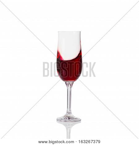 Red Wine Swirling In A Goblet Glass, Isolated On A White Background