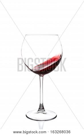 Red Wine Swirling In A Goblet Wine Glass, Isolated On A White Background