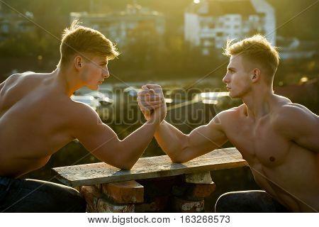 Twins Men Bodybuilders Arm Wrestling