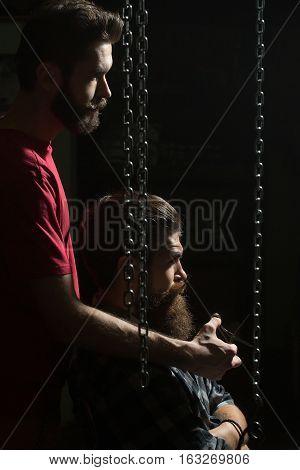 Barber Cuts Beard To Man