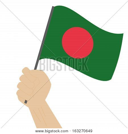 Hand holding and raising the national flag of Bangladesh
