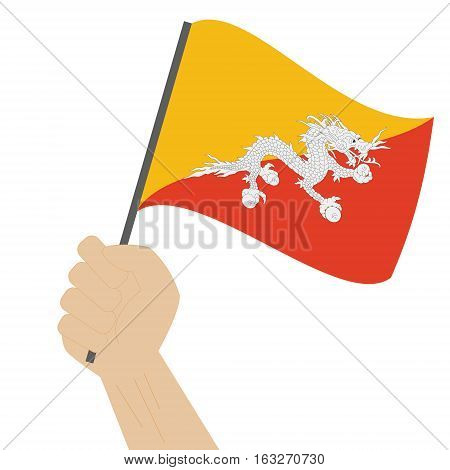 Hand holding and raising the national flag of Bhutan