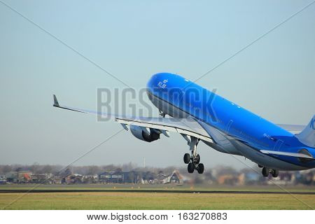 Amsterdam the Netherlands - November 25th 2016: PH-AKE KLM Royal Dutch Airlines Airbus A330 taking off from Polderbaan Runway at Amsterdam Airport Schiphol