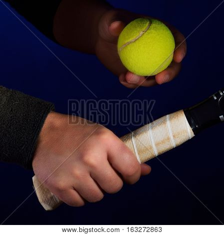 tennis racket grip and ballon blue background