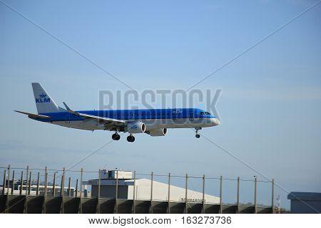 Amsterdam The Netherlands april 11 2015: PH-EZK KLM Cityhopper Embraer ERJ-190 approaching runway 09-27 Buitenveldert