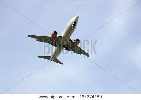 Amsterdam Schiphol Airport - April 1st 2016: OY-JTF Jettime Boeing 737-382 approaching Polderbaan runway arriving from Copenhagen Danmark