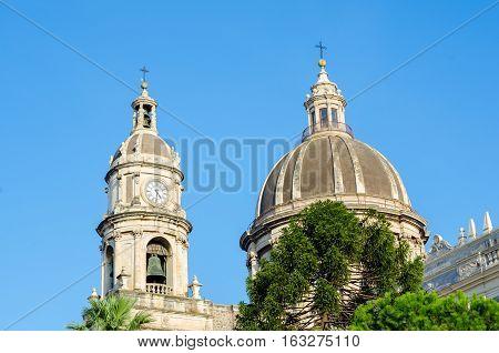 Main cupola and clock tower of the Cathedral of Santa Agatha - Catania duomo in Catania, Sicily, Italy.