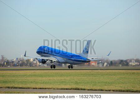Amsterdam the Netherlands - November 25th 2016: PH-EZB KLM Cityhopper Embraer ERJ-190STD taking off from Polderbaan Runway at Amsterdam Airport Schiphol