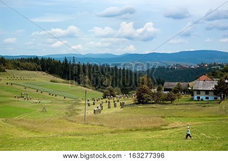 Bukovec Czech Republic - June 29 2012: Views of the village Bukovec along with fields forest and mountains in a summer day.
