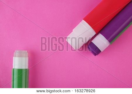 Indian Made  Glue Stick on Pink Background