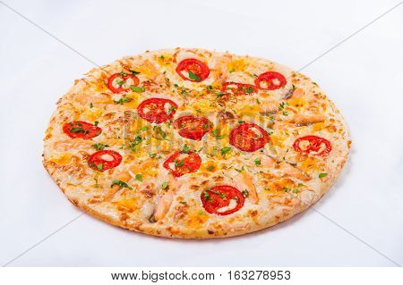 Fresh Pizza with Mozzarella Salmon Slices and Vegetables on the white background isolated. Selective focus