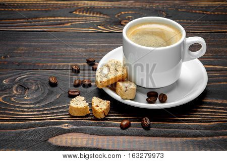 studio shot of cantuccini and coffee on wooden background