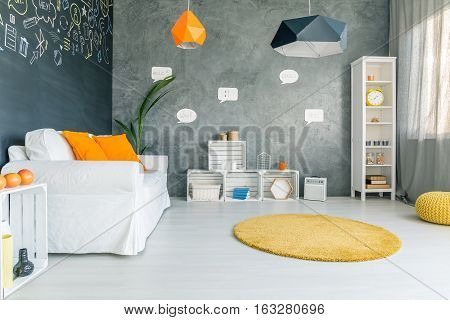Room With Sofa And Round Carpet