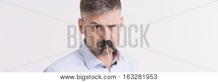 Man With Cross Face, Holding Fake Moustache