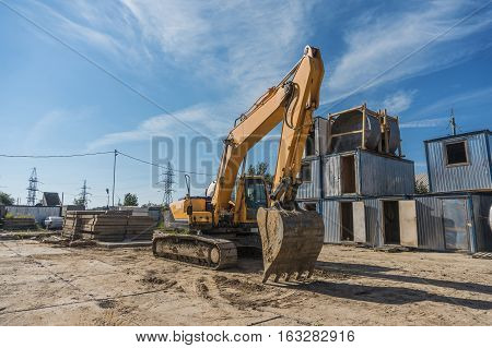 excavator on a construction site on a sunny day