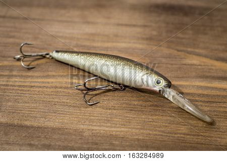 Fishing Floating Wobbler, Tackle And Spoon Bait On Wooden Board Background