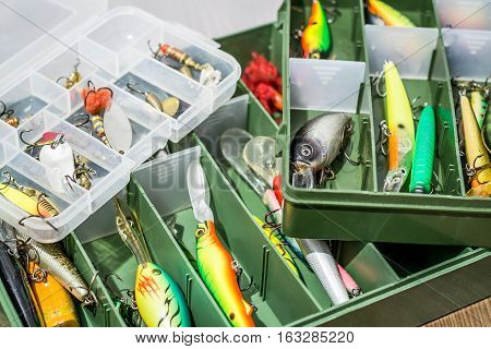 Fishing Floating Wobblers, Tackles, Spoon Baits In Box On Wood Background