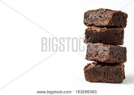 Chocolate brownie pieces isolated on white background