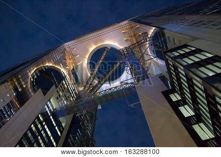 Osaka, Japan - December 10, 2014: The illuminated Umeda Sky Building at night