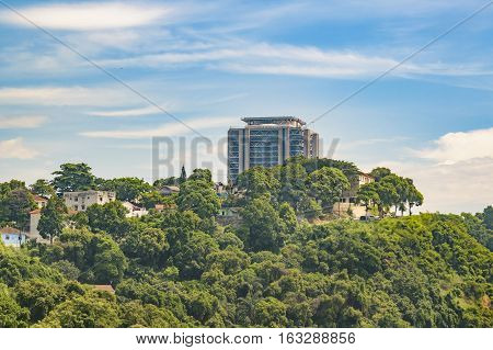 Modern buildings and leafy mountain at background in Rio de Janeiro Brazil