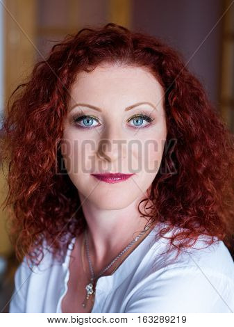 Red-haired cute girl with professional make-up closeup