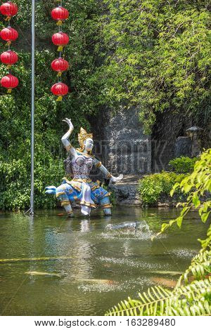 PHUKET THAILAND - CIRCA MAR 2015: Mythological characters adorn the artificial pond. In Thailand lot of bright and lovingly made heroes fairy tales