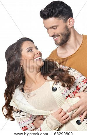 Portrait of happy young couple lookign at each other isolated on white background