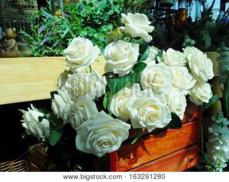 White rose on mini garden background in restaurant,Mini garden.