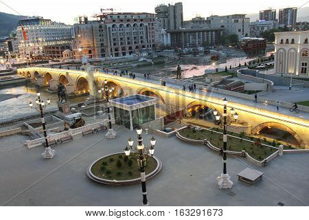 SKOPJE, REPUBLIC OF MACEDONIA-APR. 12, 2016:  Spanning across the Vardar River, the Stone Bridge connects modern Skopje to the old Turkish quarter.