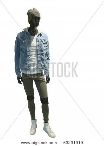 Full length male mannequin dressed in jeans jacket and destroyed trousers isolated on white background. No brand names or copyright objects.