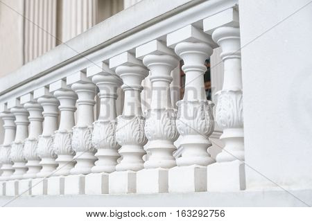 White balustrade on the restored facade of the building.