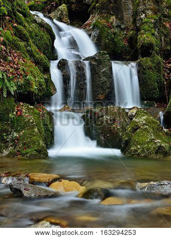 Fall landscape with huge water falling detail. Colossal cascade Tajovsky waterfall in Slovakia.