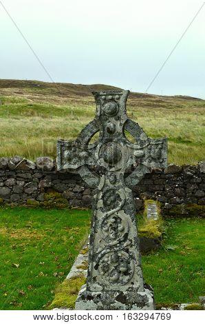 Dunvegan's cemetery with a celtic cross in Scotland.