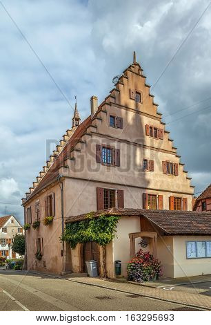 historical house on street in Dambach la Ville Alsace France