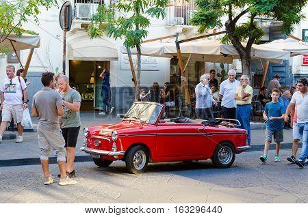 Catania, Italy - September 13, 2015: Vintage small car Autobianchi Bianchina Convertible in Catania, Sicily, Italy