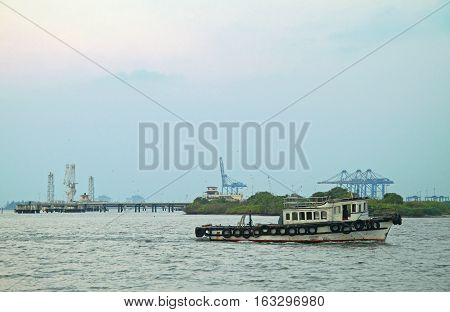 small motor boat against the background of sea port in Kochi India