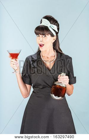 Retro Woman In Black Dress With Cosmopolitan