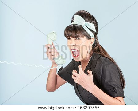 Close Up Of Yelling Retro Woman In Black Dress With Phone Receiver