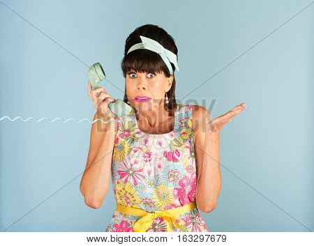 Confused Woman Holding Telephone