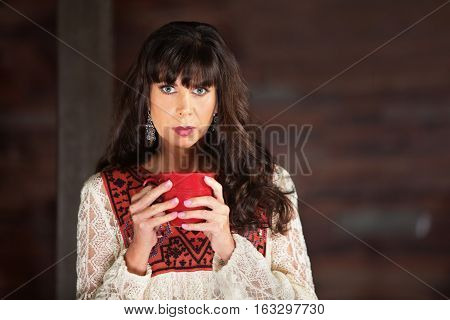 Calm Beautiful Woman Holding Red Coffee Mug