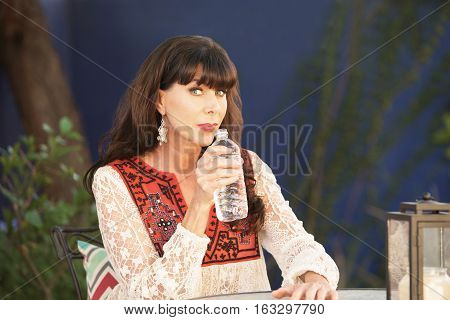Beautiful Single Woman Drinking From Water Bottle
