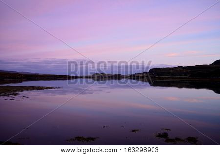 Pastel skies over Loch Dunvegan on the Isle of Skye in Scotland.