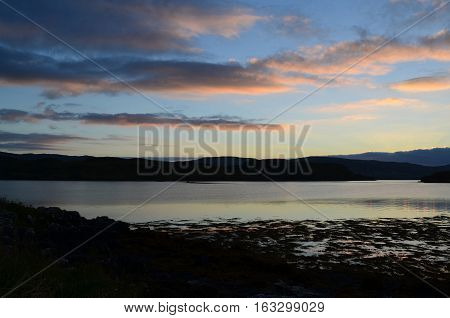 Pastel skies over Loch Dunvegan in Scotland.