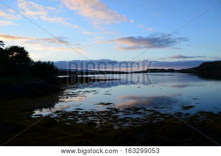Gorgeous silhouetted loch dunvegan on the Isle of Skye in Scotland.