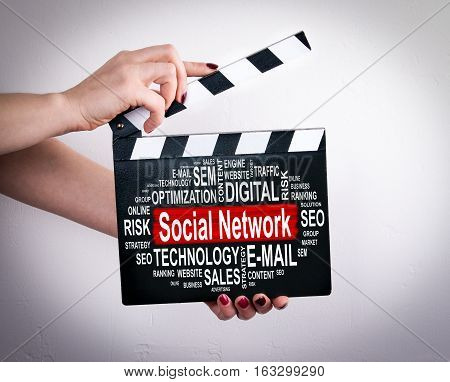 Social Network concept. Tablet computer concept. Female hands holding movie clapper.