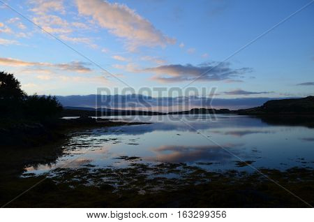 Pretty skies reflecting in Loch Dunvegan in Scotland.