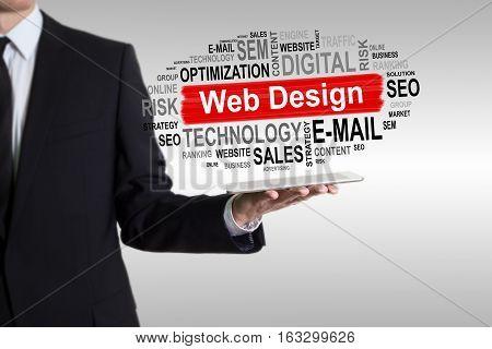 Web Design concept. Man holding a tablet computer.