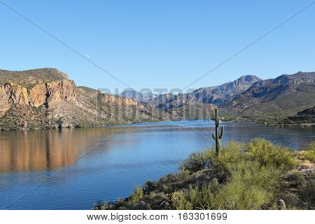 Canyon Lake Arizona in the Tonto National Forest the lake is formed by the Mormon Flat Dam on the Salt River. Horizontal image with reflections in the water.